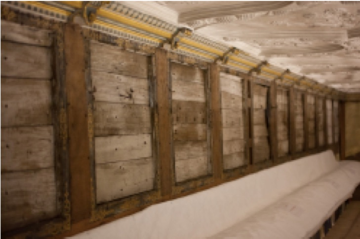 Colour photograph showing stripped back walls during conservation of the Cartoon Gallery at Knole House