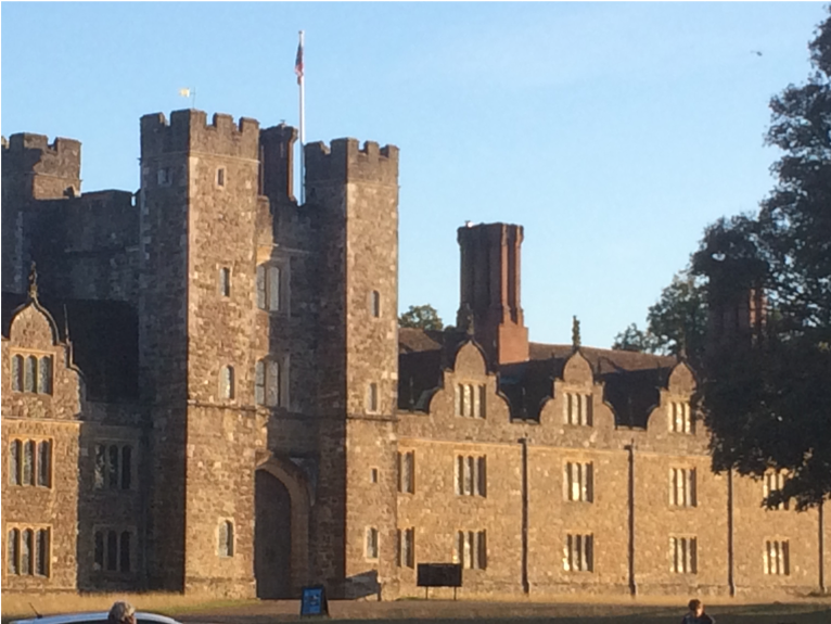 Colour photograph showing an exterior view of the towers and entrance of Knole House