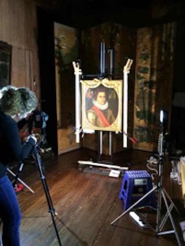 Colour photograph showing in situ examination of a painting at Knole House