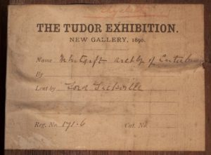 Photograph of an exhibition label for a Knole House portrait of John Whitgift lent to the 1890 Tudor Exhibition